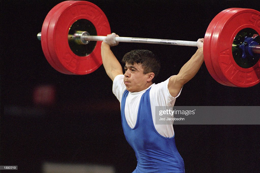Halil Mutlu of Turkey sets a new world record of 132.5 pounds in the Men's 56kg weight lifting class at the Georgia World Congress Center during the Atlanta Olympic Games in Atlanta, Georgia on July 20, 1996.