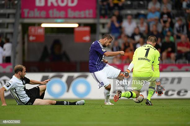 Halil Savran of Osnabrueck challenges goalkeeper Daniel Bernhardt of Aalen during the Third Liga match between VfR Aalen and VfL Osnabrueck at...
