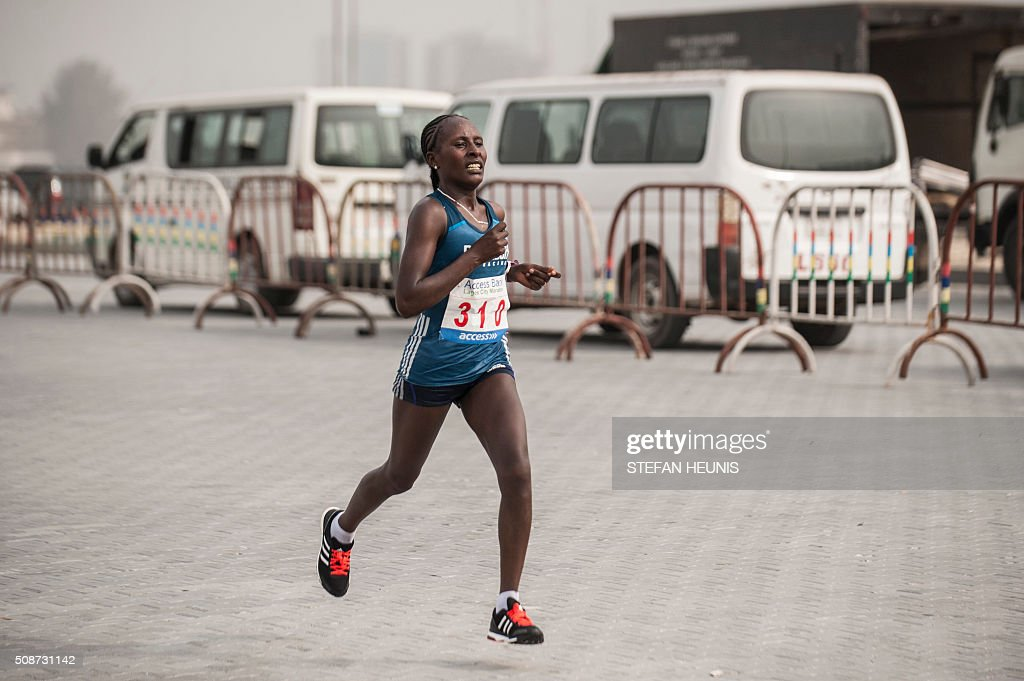 Halima Kayo from Ethiopia sprints toward the finish line to win the first Lagos City Marathon, on February 6, 2016 in Lagos. / AFP / STEFAN HEUNIS