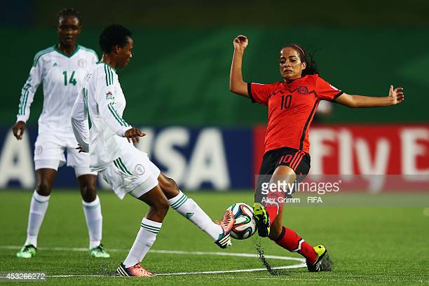 Halimatu Ayinde of Nigeria is challenged by Carolina Jaramillo of Mexico during the FIFA U20 Women's World Cup Canada 2014 group C match between...