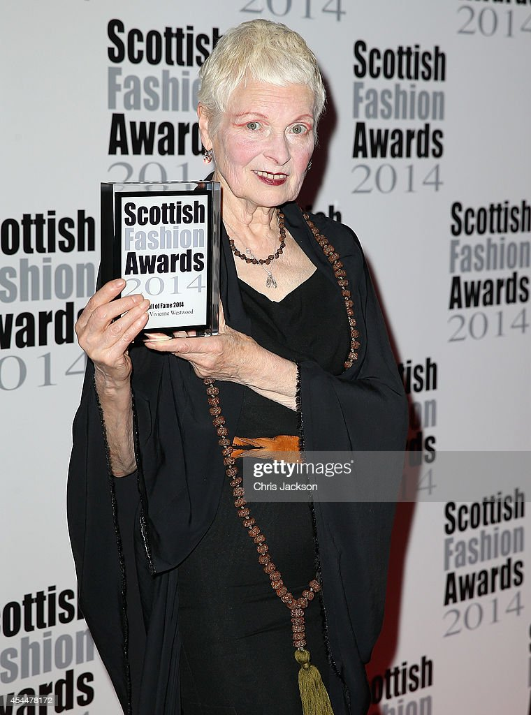 Hall of Fame Award Winner Designer Dame Vivienne Westwood poses with her Award as she attends The Scottish Fashion Awards on September 1 2014 in...