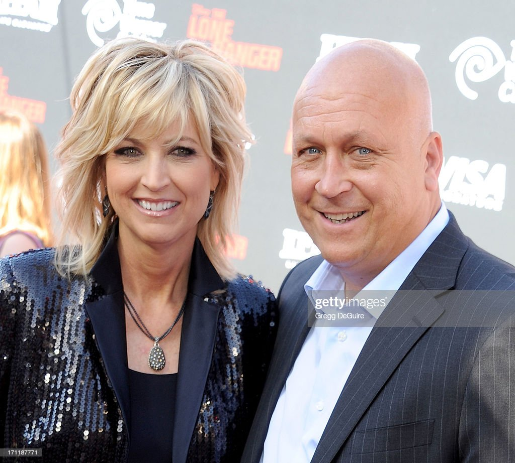 Hall of Fame baseball player Cal Ripken, Jr. (R) and wife Kelly Ripken arrive at 'The Lone Ranger' World Premiere at Disney's California Adventure on June 22, 2013 in Anaheim, California.
