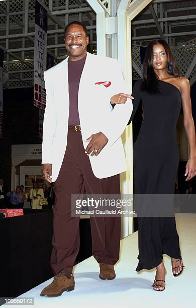 Hall of Fame baseball player Dave Winfield walks the runway