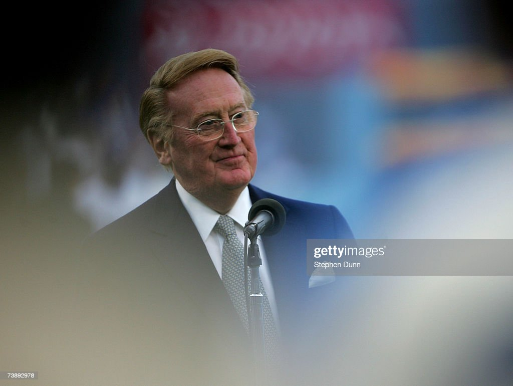 Hall of Fame broadcaster <a gi-track='captionPersonalityLinkClicked' href=/galleries/search?phrase=Vin+Scully&family=editorial&specificpeople=878517 ng-click='$event.stopPropagation()'>Vin Scully</a> speaks during ceremonies honoring Jackie Robinson before the game between the San Diego Padres and the Los Angeles Dodgers on April 15, 2007 at Dodger Stadiium in Los Angeles, California.