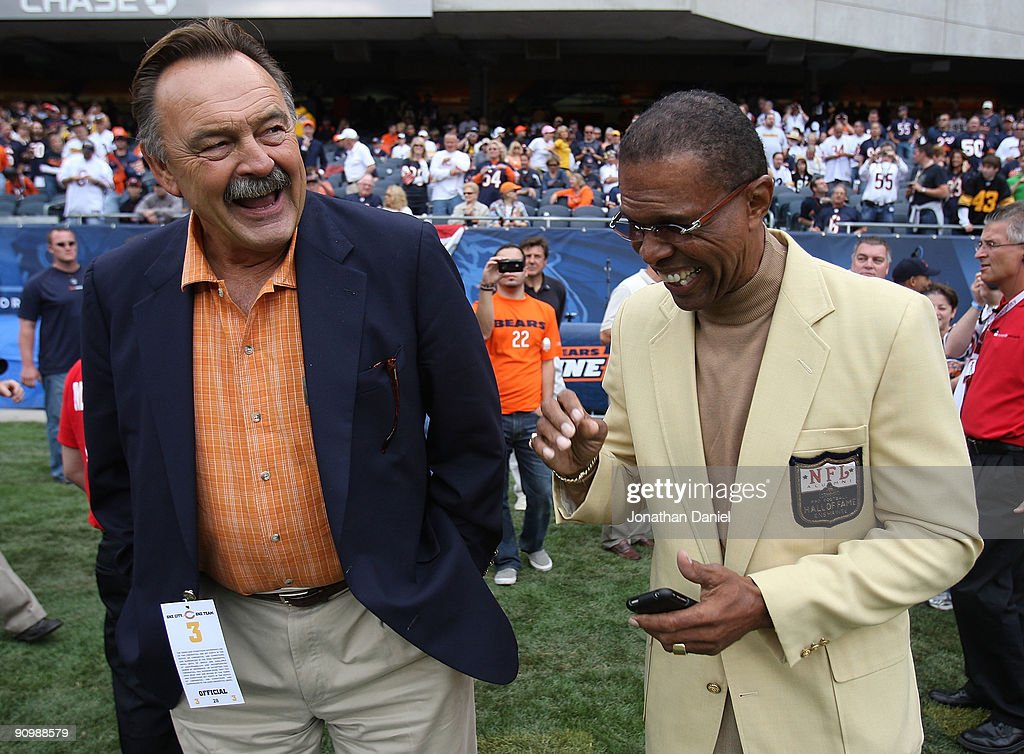 Hall of Fame Chicago Bears <a gi-track='captionPersonalityLinkClicked' href=/galleries/search?phrase=Dick+Butkus&family=editorial&specificpeople=809708 ng-click='$event.stopPropagation()'>Dick Butkus</a> (L) and <a gi-track='captionPersonalityLinkClicked' href=/galleries/search?phrase=Gale+Sayers&family=editorial&specificpeople=2024154 ng-click='$event.stopPropagation()'>Gale Sayers</a> share a laugh on the sidelines before a game between the Bears and the Pittsburgh Steelers on September 20, 2009 at Soldier Field in Chicago, Illinois. The Bears defeated the Steelers 17-14.