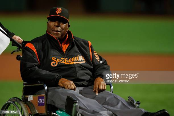 Hall of Fame first baseman Willie McCovey of the San Francisco Giants sits on the field during the 2017 Willie Mac Award ceremony before the game...