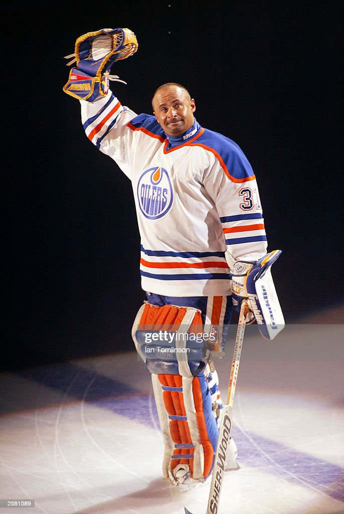 Hall of Fame goalie Grant Fuhr of the Edmonton Oilers waves to the crowd during his number retirement ceremony at the Skyreach Center October 9 2003...
