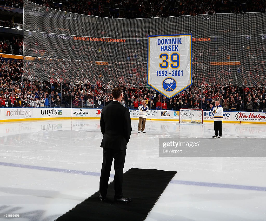 Hall of Fame goaltender Dominik Hasek of the Buffalo Sabres stands during ceremonies to retire his number 39 before their game against the Detroit...