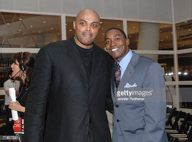 Hall of Fame inductee Charles Barkley poses for a photo with Hall of Fame member Isiah Thomas during the 2006 Basketball Hall of Fame induction...