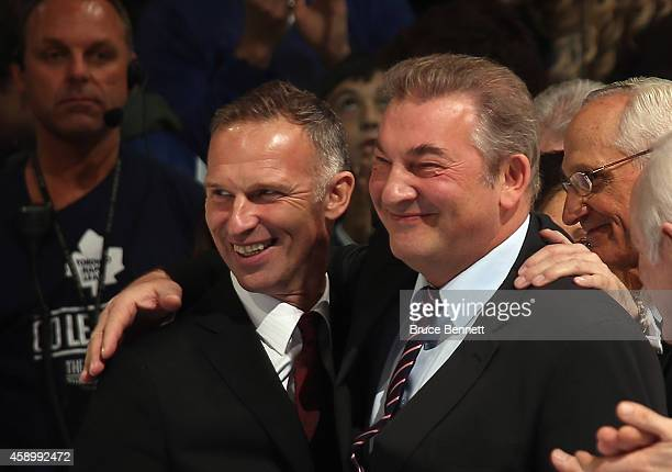 Hall of Fame inductee Dominik Hasek and Vladislav Tretiak embrace during pregame ceremonies prior to the game between the Toronto Maple Leafs and the...