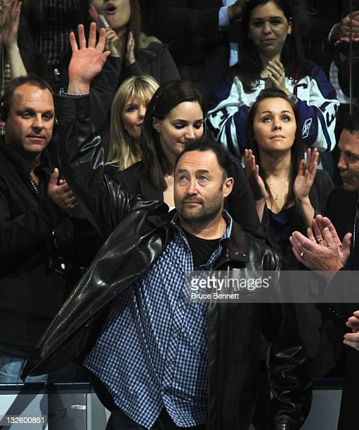 Hall of Fame inductee Ed Belfour acknowledges the crowd during a ceremony prior to the game between the Toronto Maple Leafs and the Ottawa Senators...