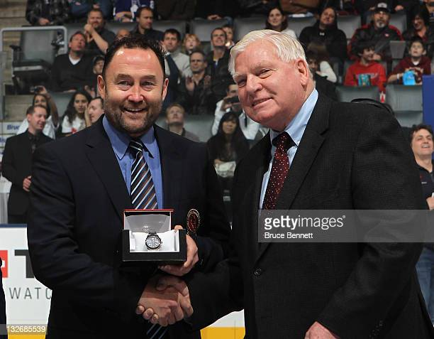 2011 Hall of Fame inductee Ed Belfour and Hall CEO Bill Hay take part in the Hall blazer presentation prior to the Legends of Hockey game at the Air...