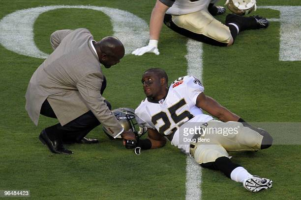 Hall of Fame inductee Emmitt Smith speaks with Reggie Bush of the New Orleans Saints prior to the start of Super Bowl XLIV between the Indianapolis...