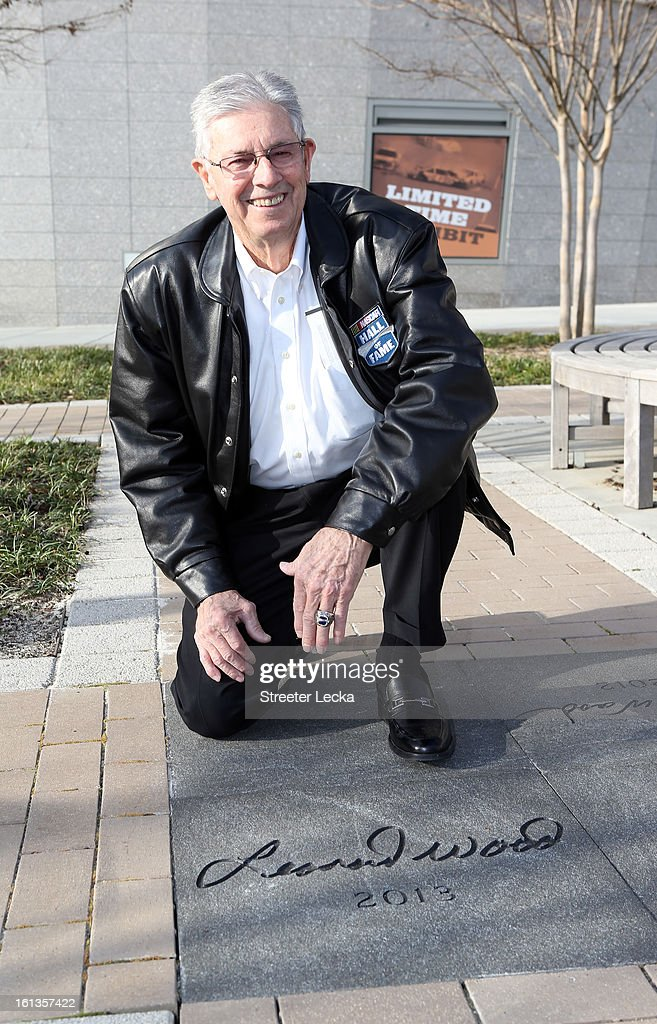 Hall of Fame inductee, Leonard Wood, poses with his engraved name during the NASCAR Hall of Fame Inductee Marker Unveiling at the NASCAR Hall of Fame on February 10, 2013 in Charlotte, North Carolina.