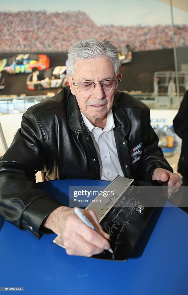 Hall of Fame inductee, Leonard Wood, signs autographs for fans during the NASCAR Hall of Fame Inductee Marker Unveiling at the NASCAR Hall of Fame on February 10, 2013 in Charlotte, North Carolina.
