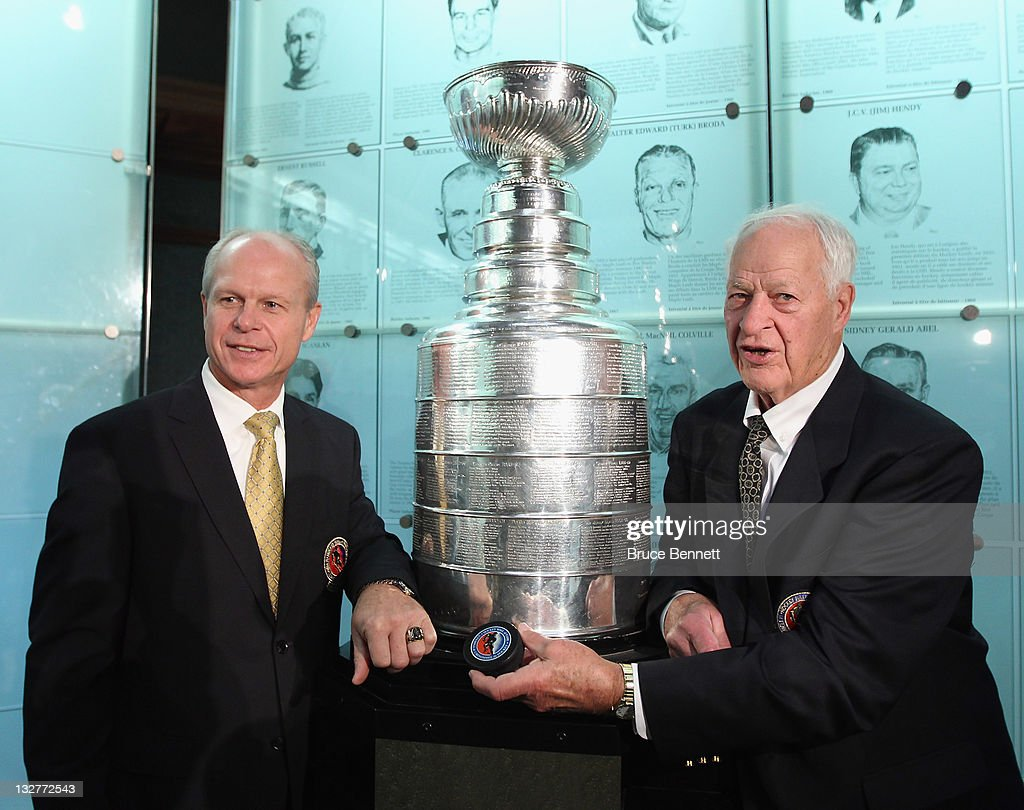 Hall of Fame inductee Mark Howe poses along with his father <a gi-track='captionPersonalityLinkClicked' href=/galleries/search?phrase=Gordie+Howe&family=editorial&specificpeople=677316 ng-click='$event.stopPropagation()'>Gordie Howe</a> during a photo opportunity at the Hockey Hall Of Fame on November 14, 2011 in Toronto, Ontario, Canada.
