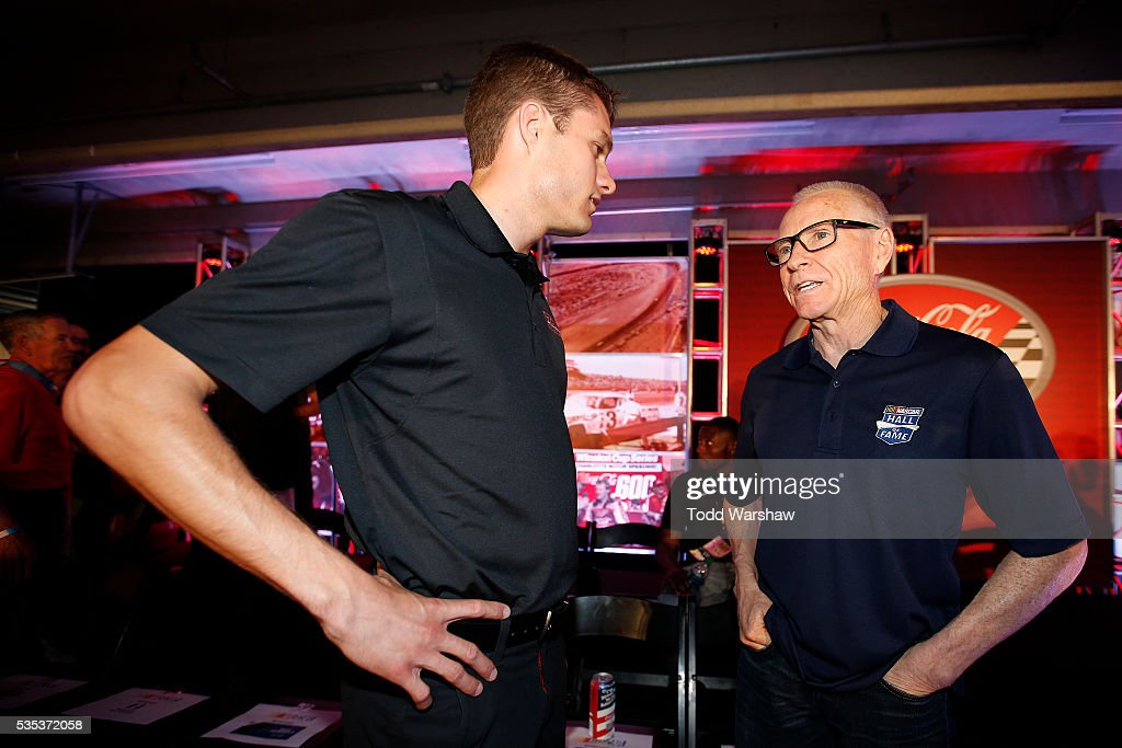 Hall of Fame inductee <a gi-track='captionPersonalityLinkClicked' href=/galleries/search?phrase=Mark+Martin&family=editorial&specificpeople=204455 ng-click='$event.stopPropagation()'>Mark Martin</a>(right) speaks with <a gi-track='captionPersonalityLinkClicked' href=/galleries/search?phrase=David+Ragan&family=editorial&specificpeople=574874 ng-click='$event.stopPropagation()'>David Ragan</a>, driver of the #23 Bubba Burger Toyota, at the driver's meeting prior to the NASCAR Sprint Cup Series Coca-Cola 600 at Charlotte Motor Speedway on May 29, 2016 in Charlotte, North Carolina.