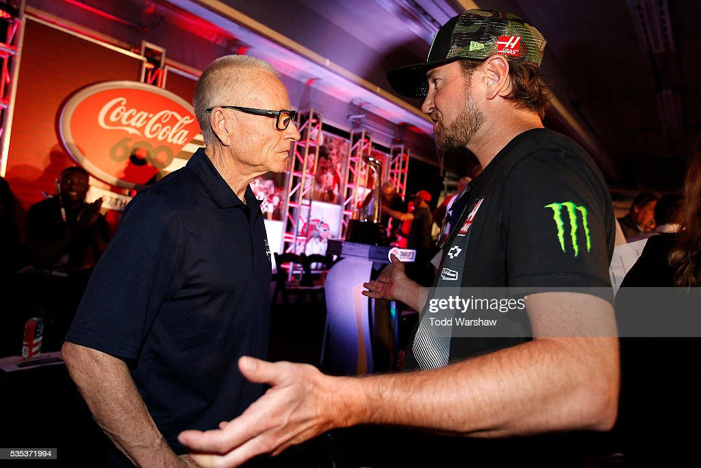 Hall of Fame inductee <a gi-track='captionPersonalityLinkClicked' href=/galleries/search?phrase=Mark+Martin&family=editorial&specificpeople=204455 ng-click='$event.stopPropagation()'>Mark Martin</a>(left) speaks with <a gi-track='captionPersonalityLinkClicked' href=/galleries/search?phrase=Kurt+Busch&family=editorial&specificpeople=201728 ng-click='$event.stopPropagation()'>Kurt Busch</a>, driver of the #41 Monster Energy/Haas Automation Chevrolet, at the driver's meeting prior to the NASCAR Sprint Cup Series Coca-Cola 600 at Charlotte Motor Speedway on May 29, 2016 in Charlotte, North Carolina.