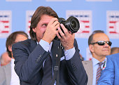 Hall of Fame inductee Randy Johnson takes a picture of fellow inductee John Smoltz during the Induction Ceremony at National Baseball Hall of Fame on...