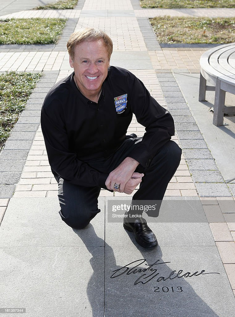 Hall of Fame inductee, <a gi-track='captionPersonalityLinkClicked' href=/galleries/search?phrase=Rusty+Wallace&family=editorial&specificpeople=201669 ng-click='$event.stopPropagation()'>Rusty Wallace</a>, poses with his engraved name during the NASCAR Hall of Fame Inductee Marker Unveiling at the NASCAR Hall of Fame on February 10, 2013 in Charlotte, North Carolina.
