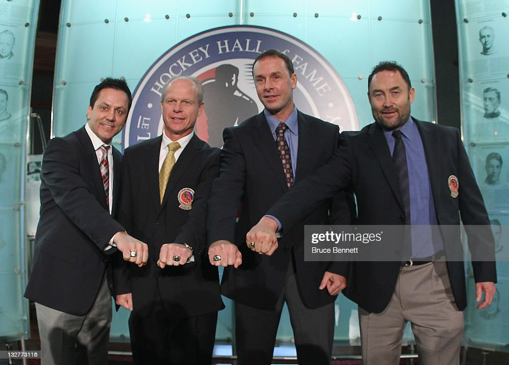 Hall of Fame inductees <a gi-track='captionPersonalityLinkClicked' href=/galleries/search?phrase=Doug+Gilmour&family=editorial&specificpeople=210813 ng-click='$event.stopPropagation()'>Doug Gilmour</a>, Mark Howe, <a gi-track='captionPersonalityLinkClicked' href=/galleries/search?phrase=Joe+Nieuwendyk&family=editorial&specificpeople=201835 ng-click='$event.stopPropagation()'>Joe Nieuwendyk</a> and <a gi-track='captionPersonalityLinkClicked' href=/galleries/search?phrase=Ed+Belfour&family=editorial&specificpeople=201872 ng-click='$event.stopPropagation()'>Ed Belfour</a> show off their Hall of Fame rings during a photo opportunity at the Hockey Hall of Fame on November 14, 2011 in Toronto, Ontario, Canada.