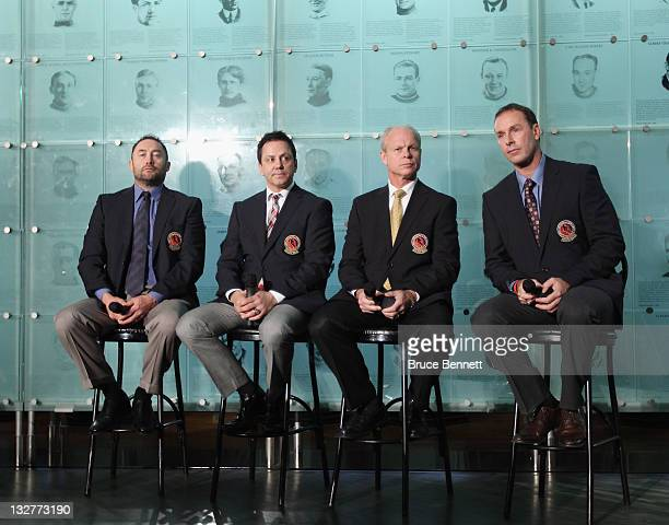 2011 Hall of Fame inductees Ed Belfour Doug Gilmour Mark Howe and Joe Nieuwendyk take part in a photo opportunity at the Hockey Hall of Fame on...