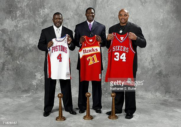 Hall of Fame inductees Joe Dumars Dominique Wilkins and Charles Barkley pose with their uniforms during the 2006 Basketball Hall of Fame induction...