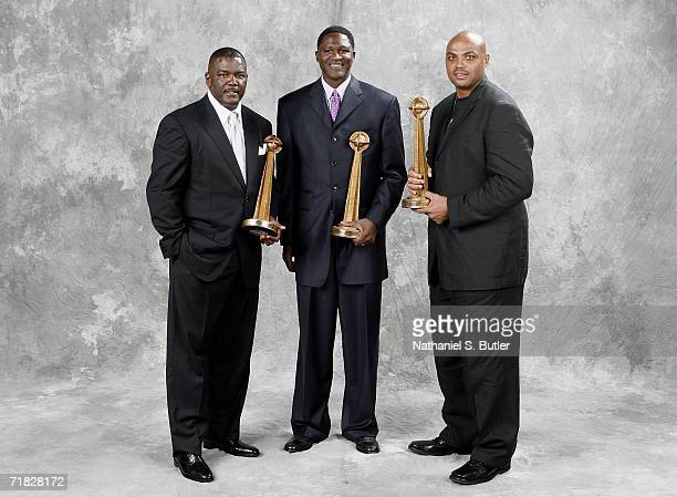 Hall of Fame inductees Joe Dumars Dominique Wilkins and Charles Barkley pose with their trophies during the 2006 Basketball Hall of Fame induction...