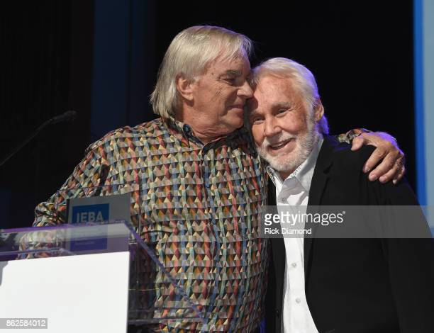 Hall of Fame Inductees Keith Bugos and Kenny Rogers speak onstage at the 2017 IEBA Honors Awards on October 17 2017 in Nashville Tennessee