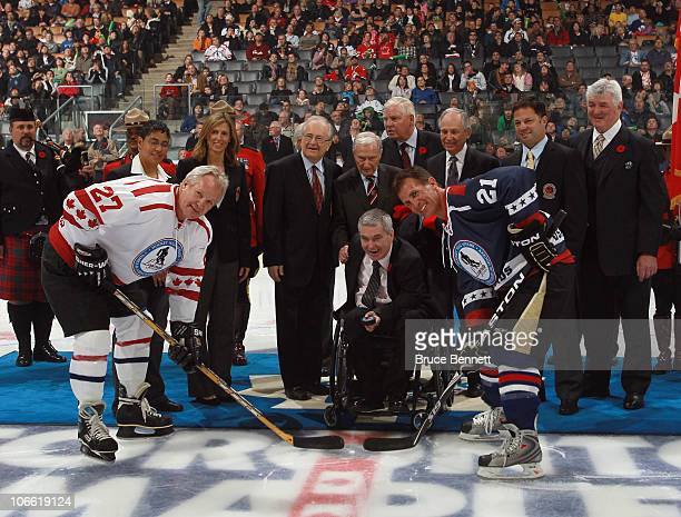 Hall of Fame inductees take part in the ceremonial faceoff between Darryl Sittler and Tony Granato prior to the Legends Classic Hockey Game at the...