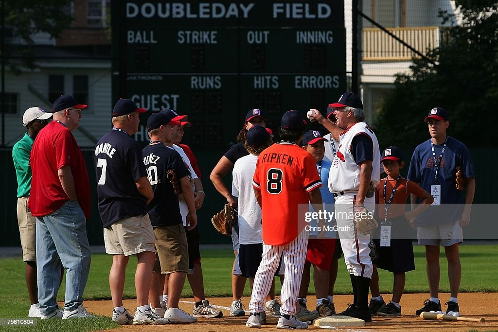 Hall of Fame member Brooks Robinson talks with fans during the Play Ball with Ozzie Smith Clinic held at Doubleday Field on July 27, 2007 in Cooperstown, New York.