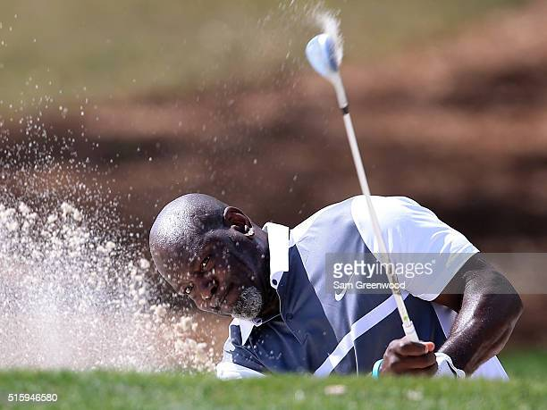 Hall of Fame member Emmitt Smith plays a shot during a preview round for the Arnold Palmer Invitational Presented By MasterCard at Bay Hill Club and...