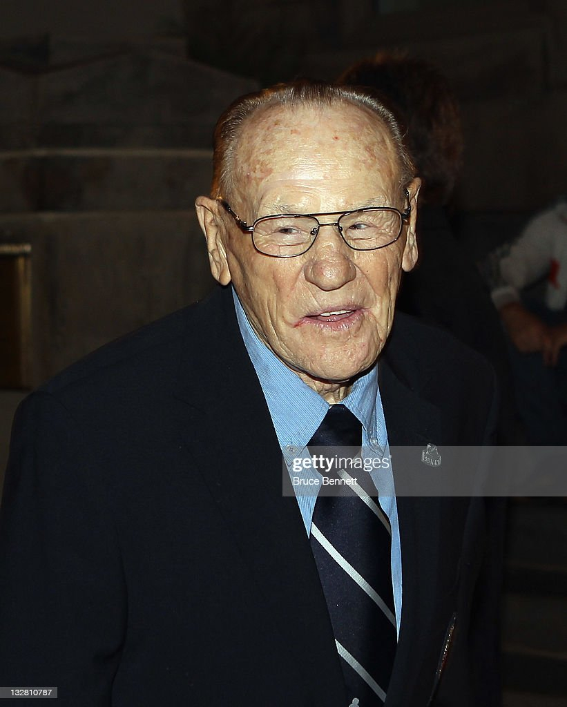 Hall of Fame member <a gi-track='captionPersonalityLinkClicked' href=/galleries/search?phrase=Johnny+Bower&family=editorial&specificpeople=239053 ng-click='$event.stopPropagation()'>Johnny Bower</a> walks the red carpet prior to the 2011 Hockey Hall of Fame Induction ceremony at the Hockey Hall Of Fame on November 14, 2011 in Toronto, Ontario, Canada.