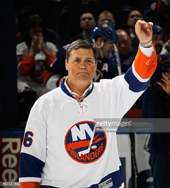 Hall of Fame member Pat Lafontaine is honored prior to the game between the New York Islanders and the Minnesota Wild at the Nassau Veterans Memorial...