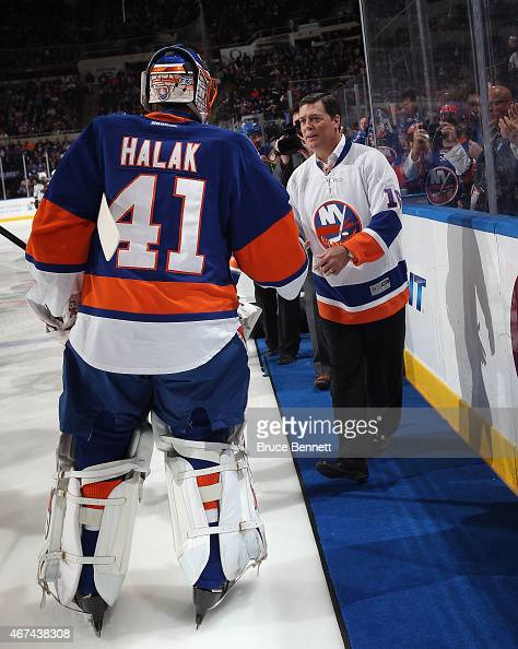 Hall of Fame member Pat Lafontaine is honored prior to the game between the New York Islanders and the Minnesota Wild and is greeted by Jaroslav...