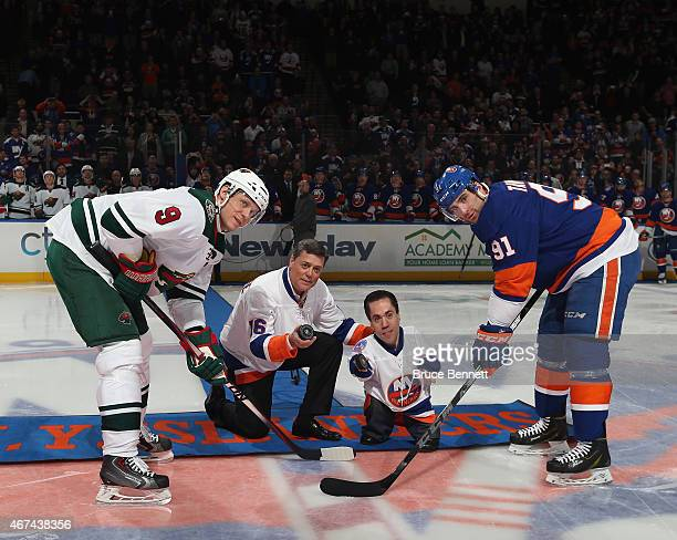Hall of Fame member Pat Lafontaine is honored prior to the game between the New York Islanders and the Minnesota Wild as he drops the opening puck...