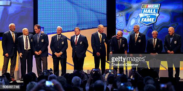 Hall of Fame members from left Dale Jarrett Bruton Smith Darrell Waltrip Junior Johnson Terry Labonte Ned Jarrett Jerry Cook Leonard Wood Rex White...