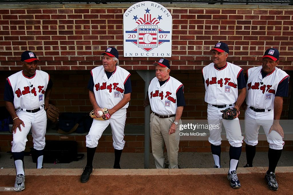Hall of Fame members from L-R, Ozzie Smith, Brooks Robinson, Earl Weaver Ryne Sandberg and George Brett wait for a photo to be taken during the Play Ball with Ozzie Smith Clinic held at Doubleday Field on July 27, 2007 in Cooperstown, New York.