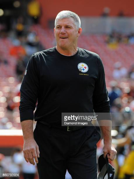 Hall of Fame offensive lineman and offensive line coach Mike Munchak of the Pittsburgh Steelers walks onto the field prior to a game on September 10...