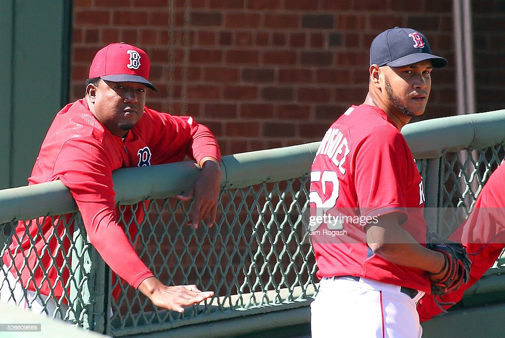 Hall of Fame pitcher <a gi-track='captionPersonalityLinkClicked' href=/galleries/search?phrase=Pedro+Martinez&family=editorial&specificpeople=171773 ng-click='$event.stopPropagation()'>Pedro Martinez</a> offers advice to Eduardo Rodriguez #52 of the Boston Red Sox, who is on the DL, in the bull pen before a game the New York Yankees at Fenway Park on April 30, 2016 in Boston, Massachusetts.