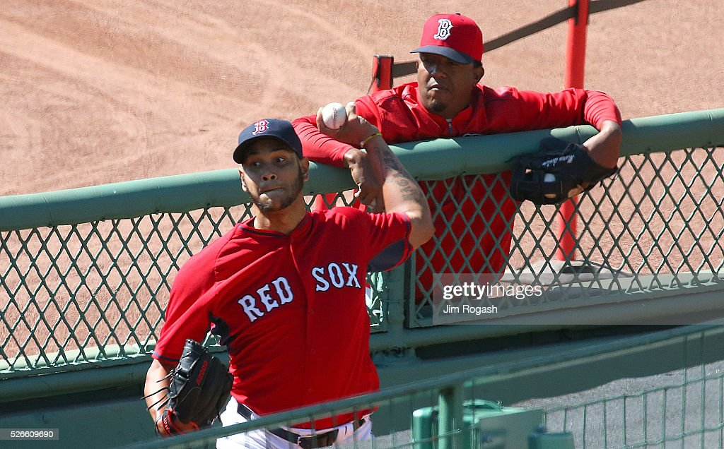Hall of Fame pitcher <a gi-track='captionPersonalityLinkClicked' href=/galleries/search?phrase=Pedro+Martinez&family=editorial&specificpeople=171773 ng-click='$event.stopPropagation()'>Pedro Martinez</a> watches Eduardo Rodriguez #52 of the Boston Red Sox, who is on the DL, throw in the bull pen before a game the New York Yankees at Fenway Park on April 30, 2016 in Boston, Massachusetts.