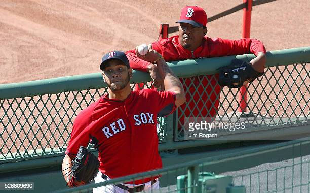Hall of Fame pitcher Pedro Martinez watches Eduardo Rodriguez of the Boston Red Sox who is on the DL throw in the bull pen before a game the New York...