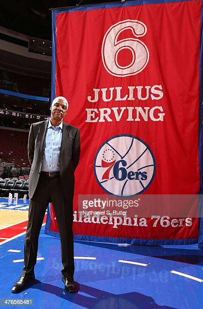 Hall of Fame Player and 76ers Legend Julius 'Dr J' Erving posed with his retired jersey banner during a game at Wells Fargo Center in Philadelphia PA...