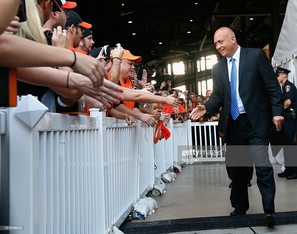 Hall of fame player and former Baltimore Orioles <a gi-track='captionPersonalityLinkClicked' href=/galleries/search?phrase=Cal+Ripken+Jr.&family=editorial&specificpeople=157500 ng-click='$event.stopPropagation()'>Cal Ripken Jr.</a> shakes hands with fans before attending a statue dedication ceremony honoring him before the start of the Orioles and New York Yankees game at Oriole Park at Camden Yards on September 6, 2012 in Baltimore, Maryland.