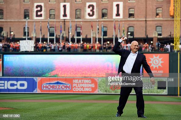 Hall of fame player and former Baltimore Orioles Cal Ripken Jr throws out the ceremonial first pitch prior to the start of a MLB game between the...