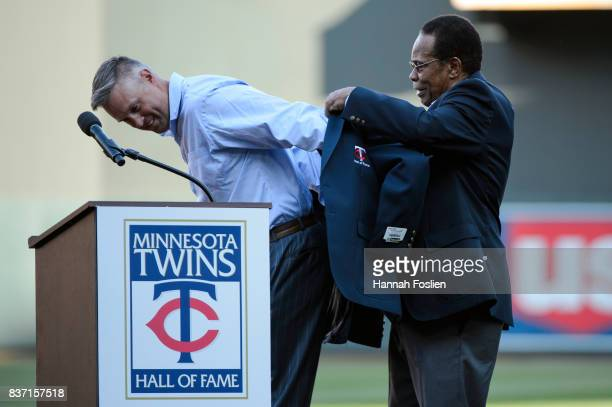 Hall of fame player Rod Carew presents former Minnesota Twins player Michael Cuddyer with a jacket as Cuddyer is inducted into the Minnesota Twins...
