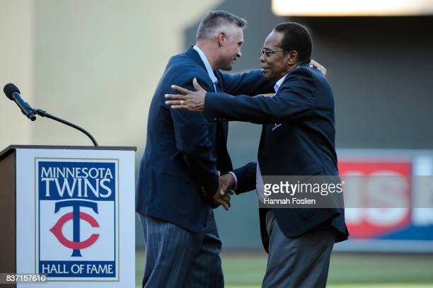 Hall of fame player Rod Carew shakes hands with former Minnesota Twins player Michael Cuddyer as Cuddyer is inducted into the Minnesota Twins Hall of...