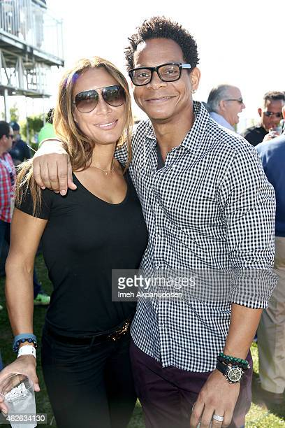 Hall of Fame professional football player Eric Davis and Serena Davis attend the DIRECTV Super Fan Tailgate at Pendergast Family Farm on February 1...