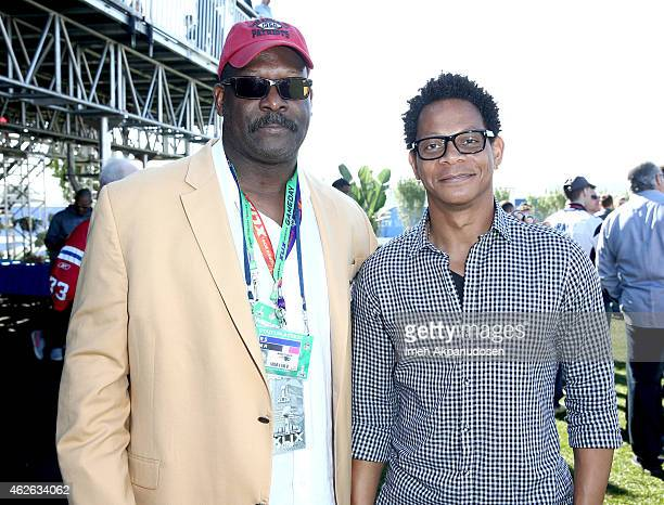 Hall of Fame professional football players Andre Tippett and Eric Davis attend the DIRECTV Super Fan Tailgate at Pendergast Family Farm on February 1...