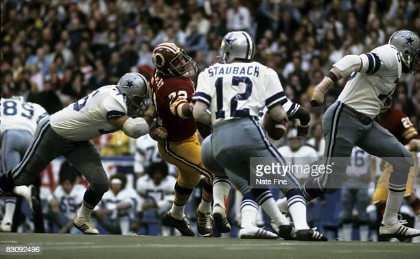 Hall of Fame quarterback Roger Staubach of the Dallas Cowboys looks for an open receiver downfield during the Cowboys 2423 Thanksgiving Day victory...
